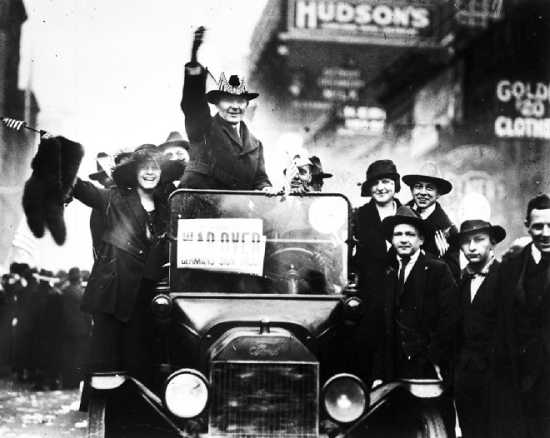 Detroiters on Woodward Avenue celebrating the end of the war, Nov. 11, 1918